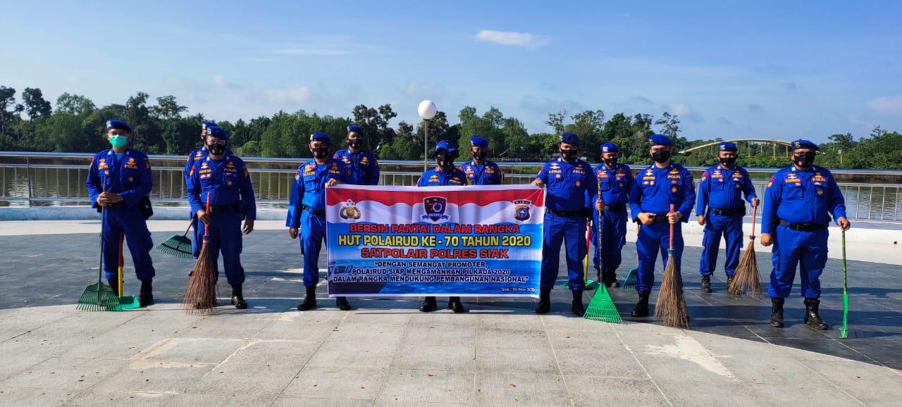 Memperingati HUT Pol Airud ke- 70, Sat Pol Air Polres Siak Bersihkan Fasilitas Umum Di Tepian Sungai Siak